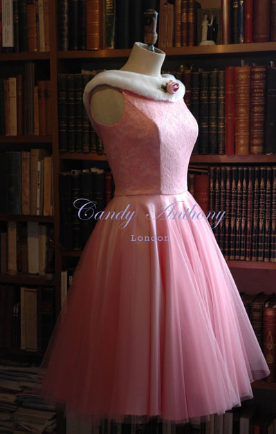 mage: Dolly Gown in antique pink trimmed with a delightful, detachable faux fur collar in Polar Bear decorated with a satin rolled rose. This gown is also available in ivory from our bridal collection.
