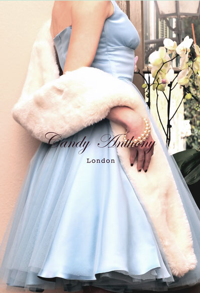 image: Powder Blue Marylin gown© with a frothy tulle overlay worn with an engagingly light faux fur stole in White Wolf, just daring to be stroked...